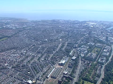 aerial shot over the outskirts and dock areas of cardiff. - cardiff wales stock videos & royalty-free footage