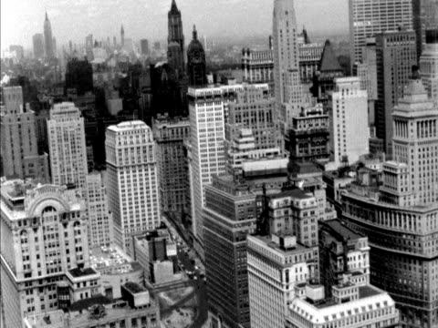 aerial shot over the skyscrapers of new york - 1961 stock-videos und b-roll-filmmaterial