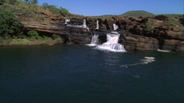 aerial shot over waterfalls and rivers - sabie stock videos and b-roll footage