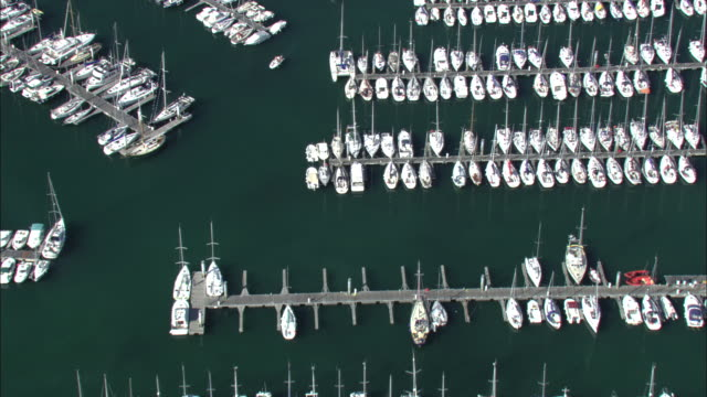 aerial shot over yachts moored at a marina in brittany.  - marina stock videos & royalty-free footage