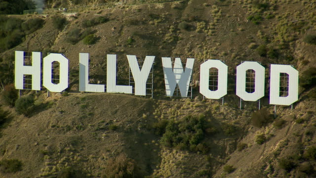 Aerial shot panning across the famous Hollywood Sign in Los Angeles, California.