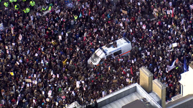 Aerial shot police surrounded by students students attacking police vanPolice have begun to disperse a group of protesters in Whitehall after...