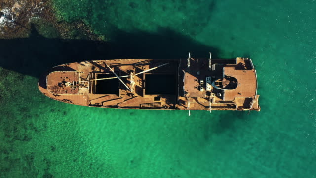 aerial shot rising up showing a shipwreck from directly above, lanzarote, spain - abandoned stock videos & royalty-free footage