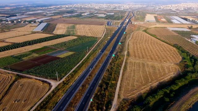 aerial shot - road crossing fields