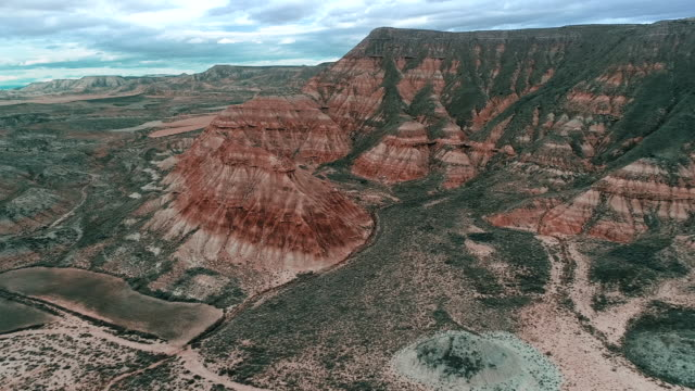 aerial shot showing bizarre mountains in the badlands, aragon, spain - geology stock videos & royalty-free footage