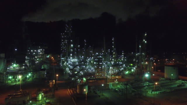 Aerial shot taken by drone;  An oil refinery plant at night, Muroran, Hokkaido, Japan.