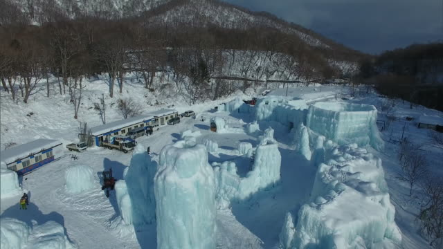 aerial shot taken by drone:chitose lake shikotsu ice festival,hokkaido,japan - satoyama scenery stock videos & royalty-free footage