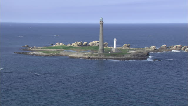 aerial shot towards and around the phare de l'ile vierge lighthouse in brittany.  - english channel stock videos and b-roll footage