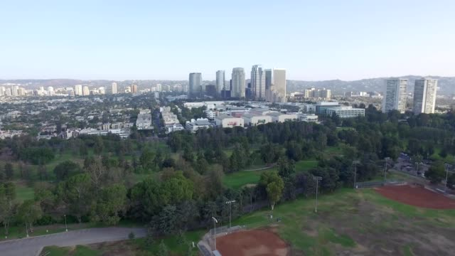 aerial shot towards century city - golfplatz green stock-videos und b-roll-filmmaterial