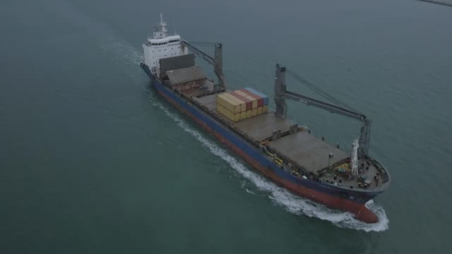 aerial shot track of container ship in ocean - commercial land vehicle stock videos & royalty-free footage
