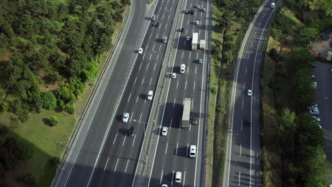 aerial shot tracking motorway - commercial land vehicle stock videos & royalty-free footage