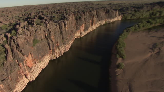 aerial shot travelling down river over cliffside in australia - eroded stock videos & royalty-free footage