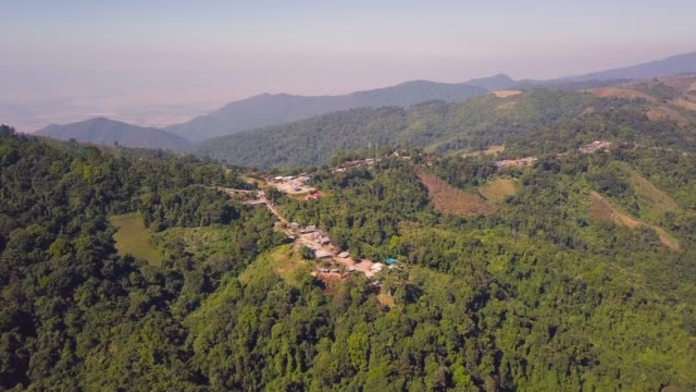 4K: Aerial shot Village with mountain landscape, Thailand.