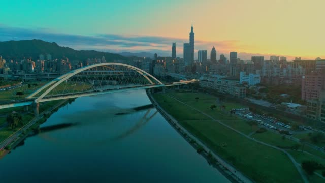 aerial shot with taipei city during sunset and bridges crossing - taipei stock videos & royalty-free footage