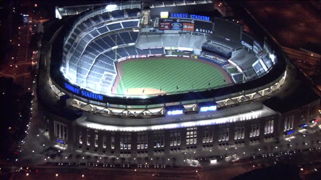 aerial shot yankee stadium at night on february 23, 2010 in new york, new york - ニューヨーク・ヤンキース点の映像素材/bロール