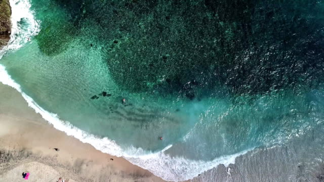 aerial shot zoom out at bali beach - zoom out stock videos & royalty-free footage