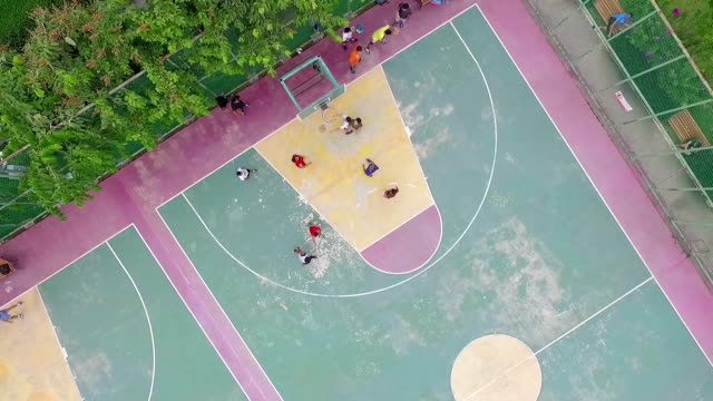 aerial shot:play basketball - playground stock videos & royalty-free footage