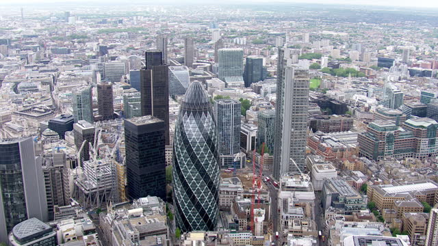 aerial shots across london city including the gherkin building st mary's axe london city aerials at the city on april 09 2013 in london - axe stock videos and b-roll footage