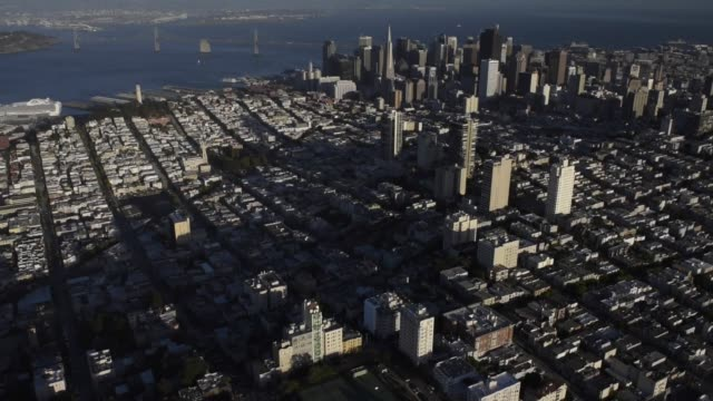 stockvideo's en b-roll-footage met aerial shots fly over san francisco california looking down at the skyline on october 5th 2015 shots various shots fly over the san francisco skyline... - fisherman's wharf san francisco