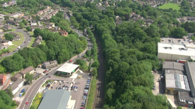 aerial shots following railway lines through the south yorkshire countryside near totley>> on june 25 2015 in sheffield united kingdom - シェフィールド点の映像素材/bロール