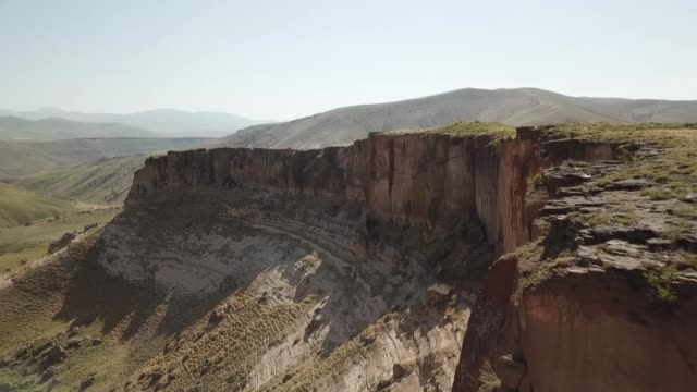 aerial shots from the rocks that include caves in ancient meya city also known as meya caves and details from the inner parts of the caves in diyadin... - archäologie stock-videos und b-roll-filmmaterial