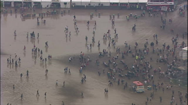 Aerial shots Glastonbury festival ground in misty weather packed with concert goers tents stages on June 25 2005 in Pilton Glastonbury England