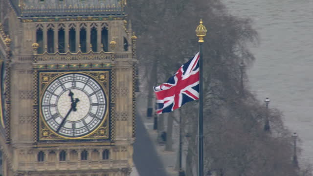 Aerial shots Houses of Parliament Westminster Palace London Eye Union Jack flag on top of Westminster Palace on March 16 2016 in London England