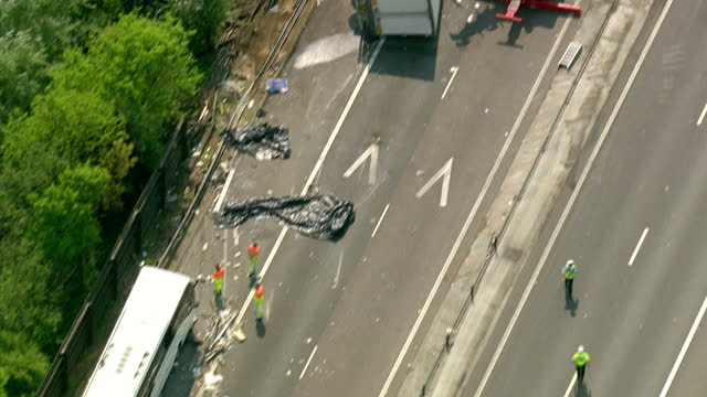 aerial shots m11 crash. two people have died after a coach collided with a lorry on a motorway in essex.the incident took place in the early hours of... - road accident stock videos & royalty-free footage