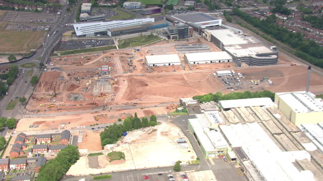 aerial shots of a brownfield site being prepared for construction diggers moving land in preparation for building on the site on july 15 2015 in... - longbridge stock videos & royalty-free footage