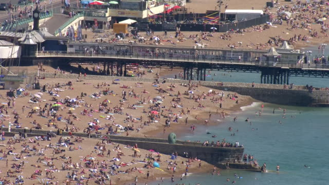 aerial shots of a busy brighton beach with people sunbathing and in the sea during the hottest day in 17 years on 7 august 2020 in brighton, united... - beach stock videos & royalty-free footage