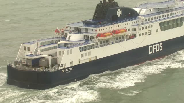 Aerial shots of a DFDS ferry leaving Dover sailing in the English Channel with a French flag on March 29 2017 in Dover England