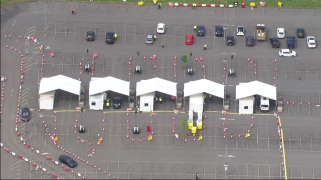 aerial shots of a drive through coronavirus testing centre at stansted airport on 1st may 2020 in london united kingdom - test drive stock videos & royalty-free footage