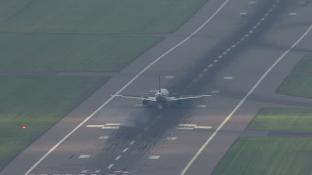 aerial shots of a german wings plane landing at stansted airport on may 15 2014 in essex england - approaching stock videos & royalty-free footage