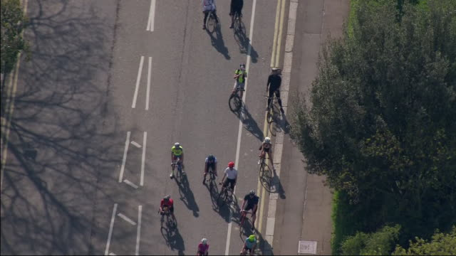 aerial shots of a group of cyclists, cycling very close together despite social distancing guidance on 10 april 2020 in central london, england - busy stock videos & royalty-free footage
