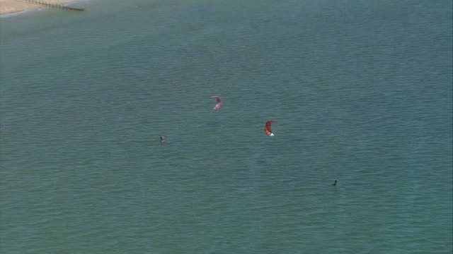 aerial shots of a kite surfer at sea off worthing beach after coronavirus lockdown measures were eased on 15 may 2020 in worthing, united kingdom - worthing点の映像素材/bロール