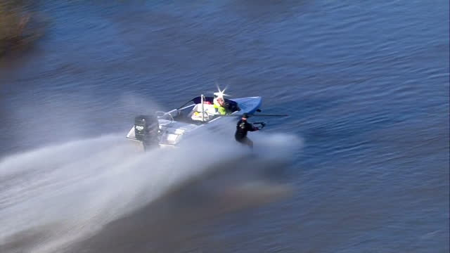 aerial shots of a man waterskiiing on the flooded river ouse near cawood.>> on december 29, 2015 in cawood, united kingdom. - river ouse stock videos & royalty-free footage