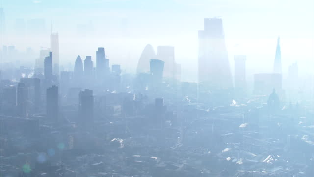 aerial shots of a misty central london skyline - smog video stock e b–roll