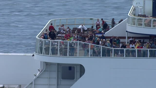 aerial shots of a p&o ferry at sea sailing towards dover, with passengers standing on an outside viewing deck.>> on august 05, 2014 in various... - ferry deck stock videos & royalty-free footage