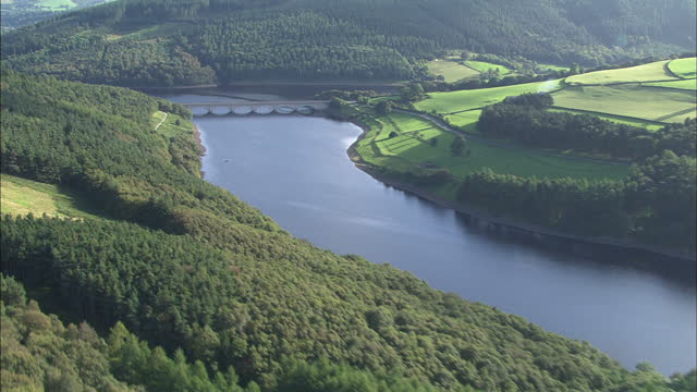 Aerial shots of a road bridge over Ladybower reservoir and surrounding forestry in the Peak District National Park on September 9 2009 in Derbyshire...