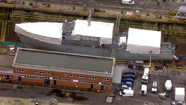 aerial shots of a royal navy ship under construction in dry docks at porsmouth naval shipyards portsmouth dockyard aerials on november 06 2013 in... - 造船所の労働者点の映像素材/bロール