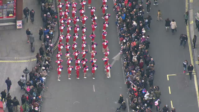 Aerial shots of a team of cheerleaders taking part in the London New Year's Day Parade as crowds lining the streets look on>> on January 01 2016 in...