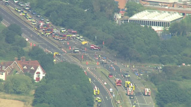aerial shots of airshow plane crash site on the a27 road with emergency vehicles at scene on august 22 2015 in shorehambysea england - ショーハム・バイ・シー点の映像素材/bロール