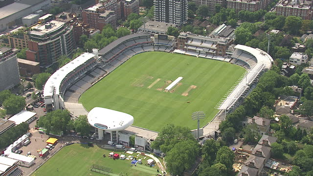 aerial shots of an empty lords cricket ground being maintained by groundsmen in the sunshine london city summer aerials on july 17 2013 in london... - lords cricket ground stock videos and b-roll footage
