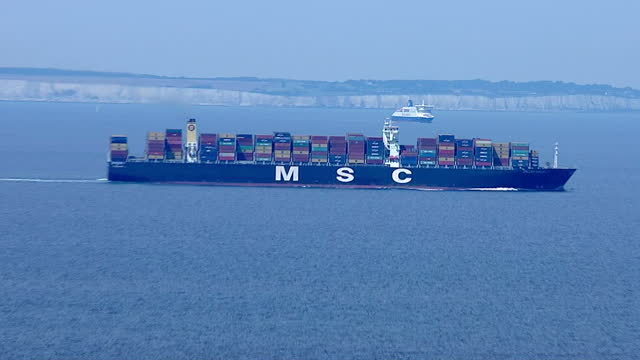 aerial shots of an msc cargo ship at sea in the english channel, stacked high with containers.>> on august 05, 2014 in various cities, france. - sea channel stock videos & royalty-free footage