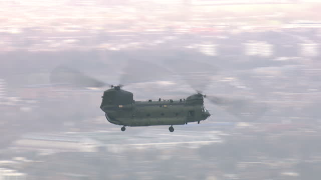 aerial shots of an raf chinook flying over the city of london flying nearby skyscrapers including the shard walkie talkie cheesegrater on february 3... - military helicopter stock videos & royalty-free footage