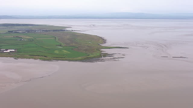 aerial shots of arnside viaduct across river leven & kent estuary on december 3, 2013 in cumbria, england. - protection stock videos & royalty-free footage