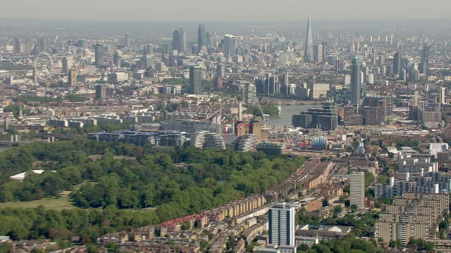 aerial shots of battersea park and vauxhall with a view of the city in the distance on september 13, 2016 in london, england. - battersea park stock videos & royalty-free footage