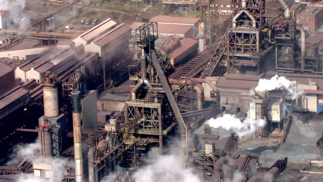 aerial shots of blast furnaces at the port talbot steelworks. >> on march 30, 2016 in port talbot, wales. - steel mill stock videos & royalty-free footage