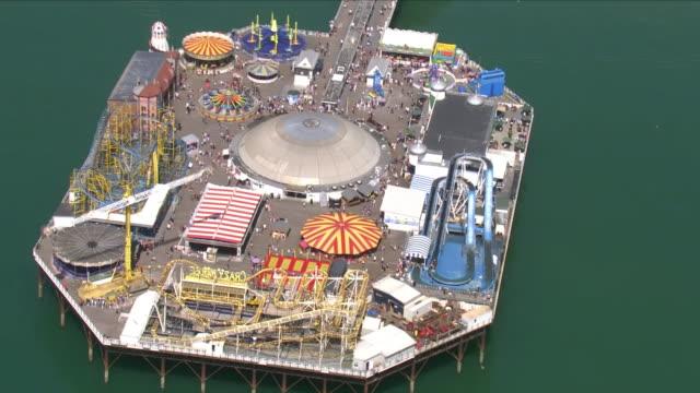 aerial shots of brighton pier and funfair on 7 may 2018 in brighton, united kingdom - イーストサセックス点の映像素材/bロール