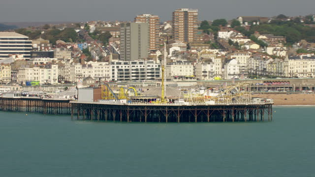aerial shots of brighton pier with the amusement park on a sunny day on september 13, 2016 in brighton, england. - sunny video stock e b–roll